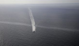 In this March 31, 2015, photo, a supply vessel crosses an oil sheen drifting from the site of the former Taylor Energy oil rig in the Gulf of Mexico, off the coast of Louisiana. Capitol Hill lawmakers from Louisiana have intervened on behalf of Taylor Energy Company that has failed to stop a decade-old oil leak in the Gulf of Mexico but lobbied for a refund of money reserved for spill containment work, according to letters obtained by The Associated Press through public records requests. (AP Photo/Gerald Herbert, File