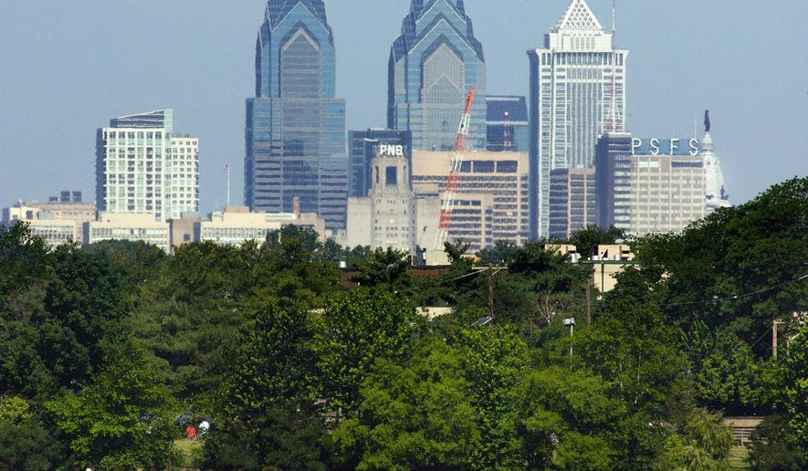 FILE - This June 2, 2011 file photo, shows the skyline of downtown Philadelphia in this view from Camden, N.J. The Federal Reserve Bank of Philadelphia releases its July report on manufacturing in the Philadelphia region on Thursday, July 16, 2015. (AP Photo/Tom Mihalek, File)