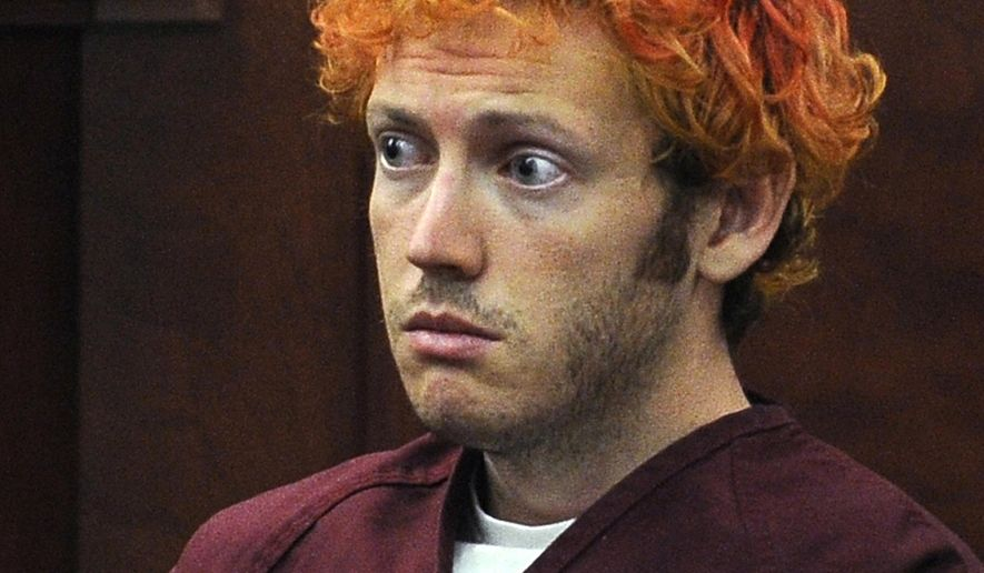 FILE - In this July 23, 2012 file photo, James Holmes, who is charged with killing 12 moviegoers and wounding 70 more in a shooting spree in a crowded theatre in 2012, sits in Arapahoe County District Court in Centennial, Colo. On Thursday, July 16, 2015, a jury found Holmes guilty of murder in the methodically planned attack. The verdict means the 27-year-old former neuroscience graduate student could get the death penalty for the shooting. (RJ Sangosti/The Denver Post via AP, Pool, File)