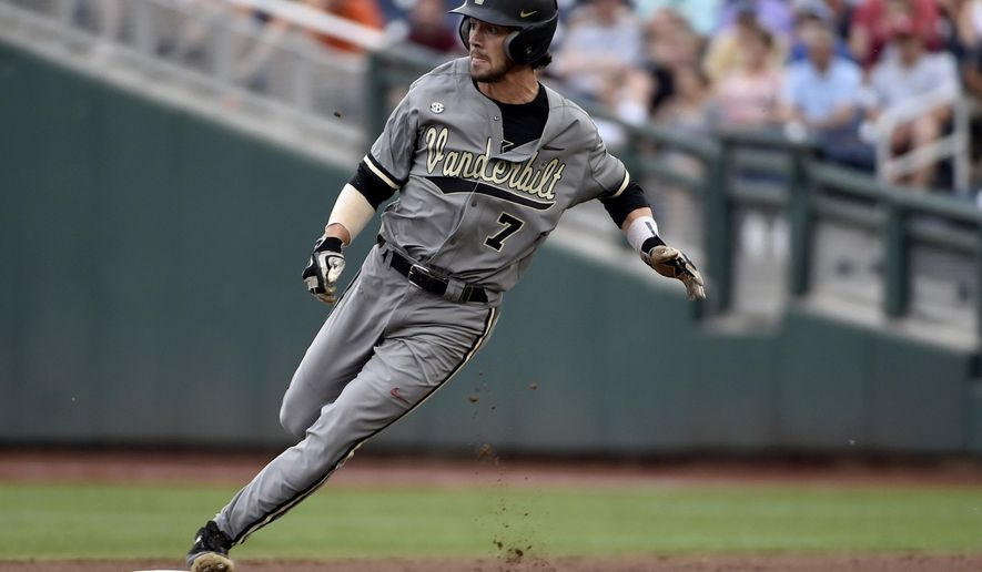 FILE - In this June 23, 2015, file photo, Vanderbilt's Dansby Swanson rounds second base on his way to third on a teammate's single against Virginia during Game 2 of the best-of-three NCAA baseball College World Series finals in Omaha, Neb. Just three of the 36 first-round draft picks are unsigned as Friday's deadline approaches: Vanderbilt shortstop Swanson, taken by Arizona with the No. 1 selection, and a pair of Dodgers choices: Vanderbilt right-hander Walker Buehler (24th) and Louisville right-hander Kyle Funkhouser (35th). (AP Photo/Mike Theiler, File)