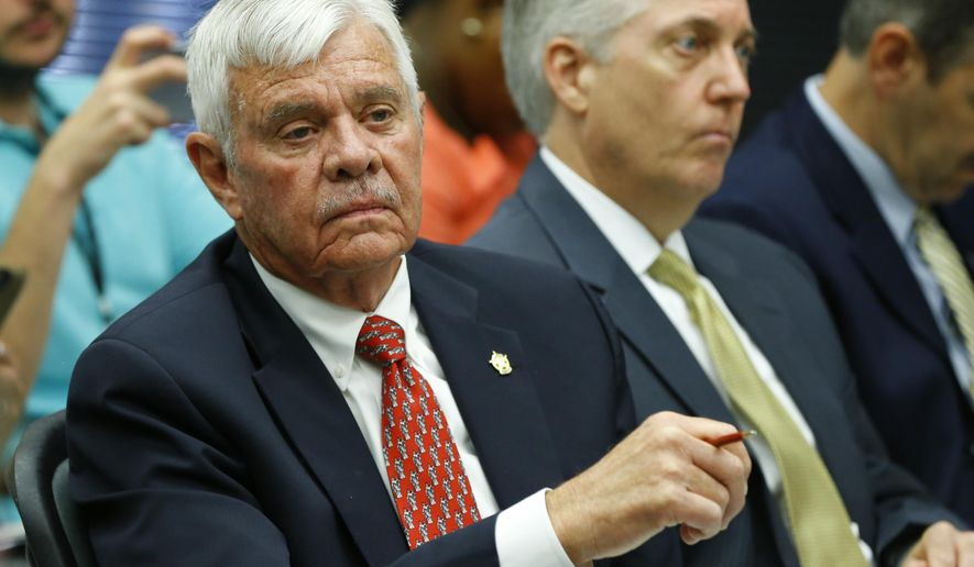 FILE - In this July 13, 2015 file photo, Tulsa County Sheriff Stanley Glanz listens to proceedings of a county commissioners meeting in Tulsa, Okla. The Oklahoma Supreme Court on Thursday, July 16, 2015 refused to delay a grand jury investigation into the Tulsa sheriff's office after a former volunteer deputy fatally shot an unarmed and restrained man in April, 2015. (AP Photo/Sue Ogrocki, File)