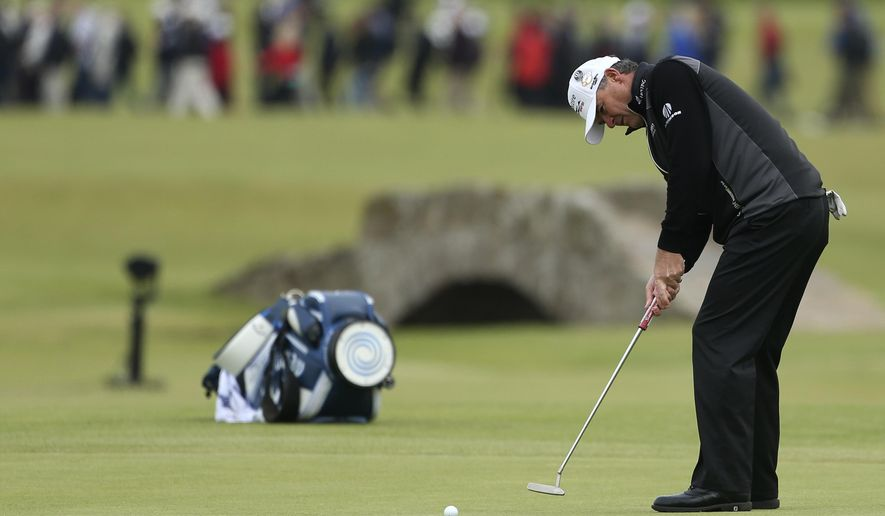 Scotland Paul Lawrie putts on the 17th green during the first round of the British Open Golf Championship at the Old Course, St. Andrews, Scotland, Thursday, July 16, 2015. (AP Photo/Peter Morrison)