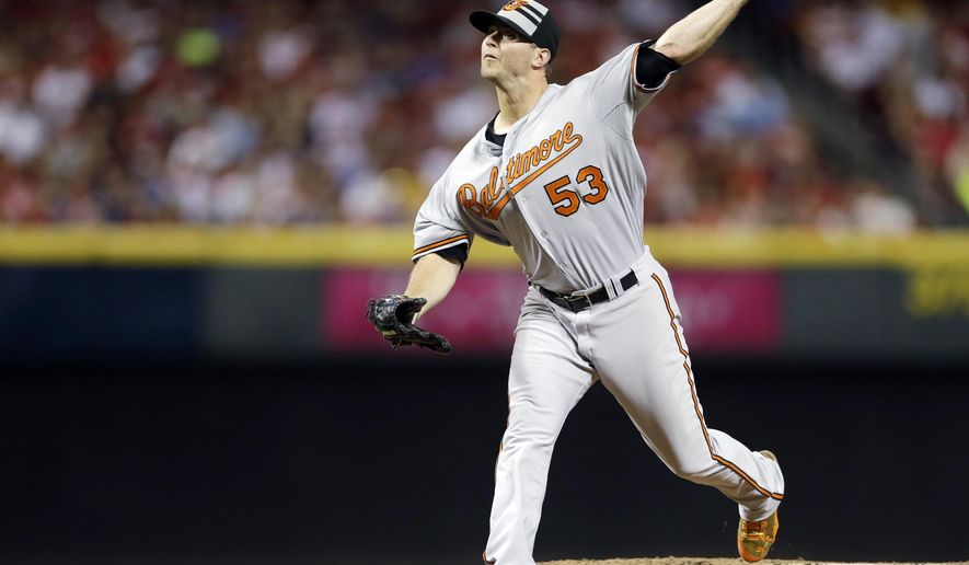 American League's Zach Britton, of the Baltimore Orioles, throws during the sixth inning of the MLB All-Star baseball game, Tuesday, July 14, 2015, in Cincinnati. (AP Photo/Jeff Roberson)