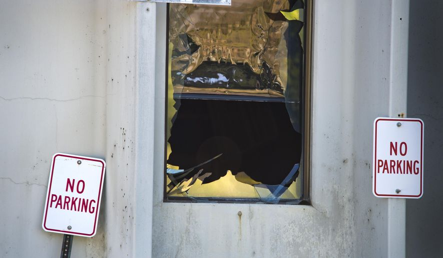 An explosion shattered windows and damaged loading docks at the Zodiac Aerospace plant Wednesday, July 15, 2015, in Newport, Wash. An explosion rocked an aerospace plant in northeast Washington, toppling large pieces of machinery, lifting an entire floor off its foundation and injuring five people, authorities said Wednesday. (Dan Pelle/The Spokesman-Review via AP) COEUR D'ALENE PRESS OUT; MANDATORY CREDIT