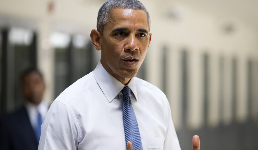 President Barack Obama speaks at the El Reno Federal Correctional Institution,  in El Reno, Okla., Thursday, July 16, 2015. As part of a weeklong focus on inequities in the criminal justice system, the president will meet separately Thursday with law enforcement officials and nonviolent drug offenders who are paying their debt to society at the El Reno Federal Correctional Institution, a medium-security prison for male offenders near Oklahoma City. (AP Photo/Evan Vucci)