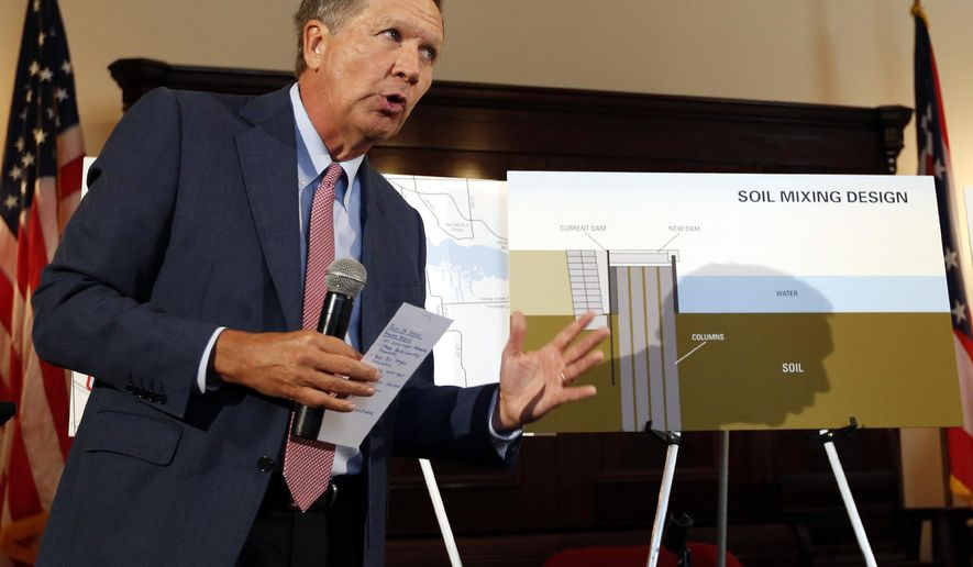 Gov. John Kasich discusses the plans to repair Buckeye Lake's dam during a news conference in his office, Thursday, July 16, 2015 at the Ohio Statehouse in Columbus, Ohio. Work to replace the deteriorated dam at Buckeye Lake could start as early as this year with a design that Ohio officials said Thursday could accelerate the project and potentially save money. (Adam Cairns/The Columbus Dispatch via AP) MANDATORY CREDIT
