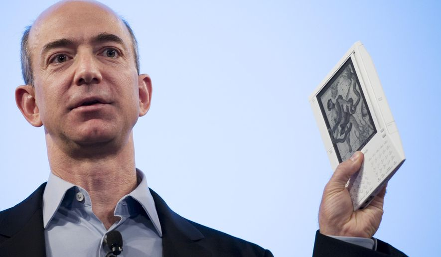 FILE - In this Nov. 19, 2007 file photo, Jeff Bezos, founder and CEO of Amazon, introduces the Kindle at a news conference in New York. Amazon launched at the dawn of the Web as an online bookseller twenty years ago on July 16, 1995. (AP Photo/Mark Lennihan, File)