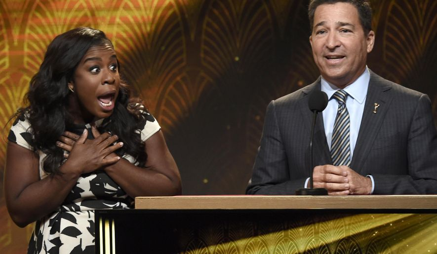 Uzo Aduba, right,  reacts as Bruce Rosenblum, chairman and CEO, Academy of Television Arts & Sciences, announces she is nominated for outstanding supporting actress in a drama series at the 67th Primetime Emmy Nominations Announcements at the Pacific Design Center on Thursday July 16, 2015, in West Hollywood, Calif. (Photo by Chris Pizzello/Invision/AP)