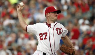 Washington Nationals starting pitcher Jordan Zimmermann (27) throws during the third inning of a baseball game against the Los Angeles Dodgers at Nationals Park, Friday, July 17, 2015, in Washington. (AP Photo/Alex Brandon)