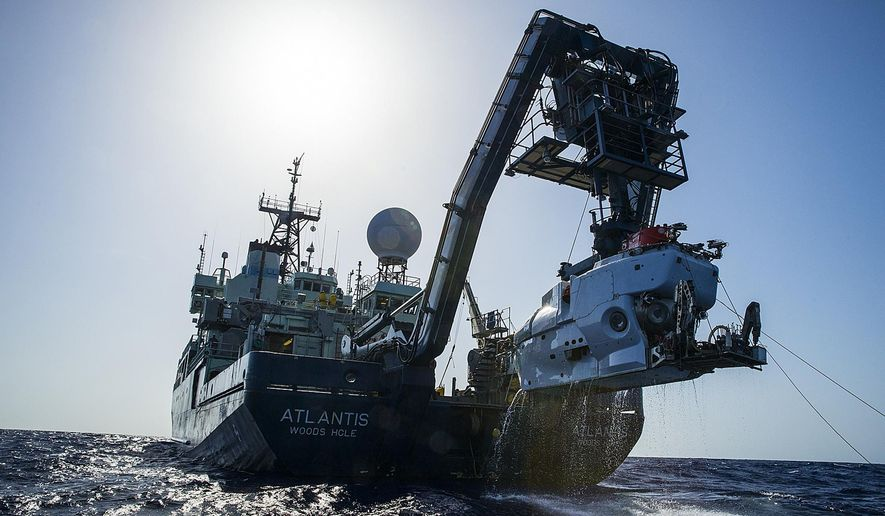 In this image released by, The Woods Hole Oceanographic Institution, the research vessel Atlantis is shown off the coast of the Carolinas in the Atlantic Ocean during the second week of July 2015 with the submersible Alvin hanging off its stern. The expedition led by Duke University marine scientist Cindy Van Dover has found a shipwreck that may date back to the late 1700s. (Luis Lamar/Woods Hood Oceanographic Institution via AP)