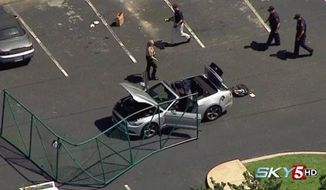 In this aerial image taken from video, law enforcement personnel work the scene of a shooting at the Navy Operational Support Center and Marine Corps Reserve Center Chattanooga Thursday, July 17, 2015, in Chattanooga, Tenn. Authorities say Kuwait-born Muhammad Youssef Abdulazeez, 24, of Hixson, Tenn., unleashed a barrage of gun fire from his car at a recruiting center and the U.S. military site, killing at least four Marines before he was shot to death by police. (WTVF via AP) MANDATORY CREDIT, NO SALES