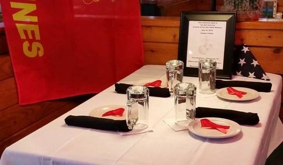 A former Marine who manages a Chattanooga, Tennessee, restaurant honored the four troops killed by a gunman in a July 16 attack on two nearby military facilities by setting a table as a memorial. (WTVC)