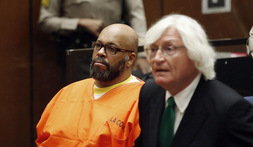 "In this Tuesday, July 7, 2015, photo, Marion Hugh ""Suge"" Knight, left, sits with his attorney Thomas Mesereau, in Los Angeles Superior Court, during a hearing in a murder case filed against the Death Row Records co-founder. The former rap music mogul Knight returns to court on Friday, July 17, to ask that a judge reduce his bail on murder and attempted murder charges from $10 million.  (Patrick T. Fallon/Pool Photo via AP, File)"
