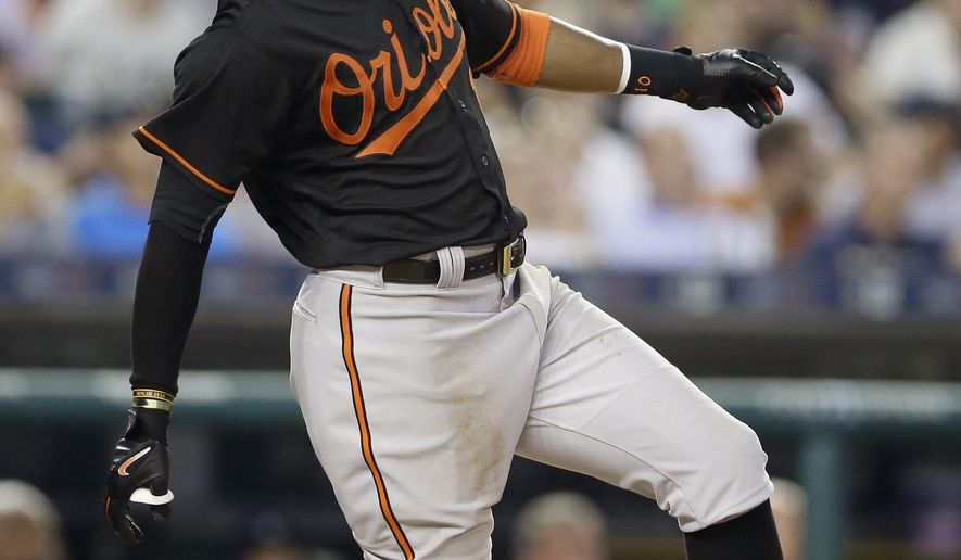Baltimore Orioles' Adam Jones reacts after popping up to Detroit Tigers second baseman Ian Kinsler during the seventh inning of a baseball game, Friday, July 17, 2015, in Detroit. (AP Photo/Carlos Osorio)