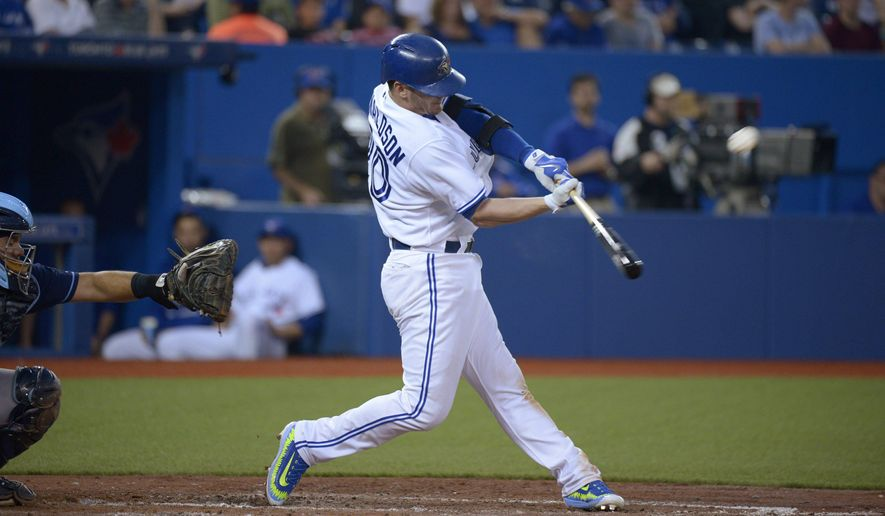 Toronto Blue Jays' Josh Donaldson hits a two-run home run, also driving in Devon Travis, against the Tampa Bay Rays during the fifth inning of a baseball game Friday, July 17, 2015, in Toronto. (Jon Blacker/The Canadian Press via AP) MANDATORY CREDIT