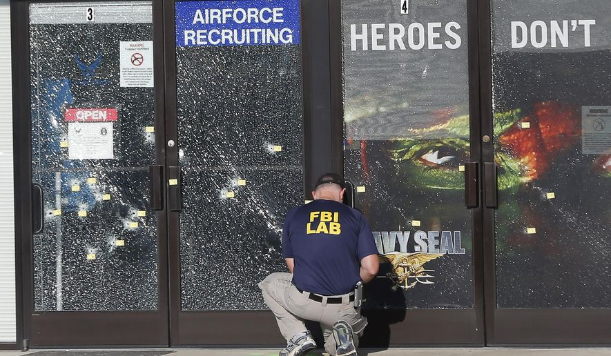 An FBI investigator investigates the scene of a shooting outside a military recruiting center on Friday, July 17, 2015, in Chattanooga, Tenn. Muhammad Youssef Abdulazeez of Hixson, Tenn.,  attacked two military facilities on Thursday, in a shooting rampage that killed four Marines. (AP Photo/John Bazemore) **FILE**