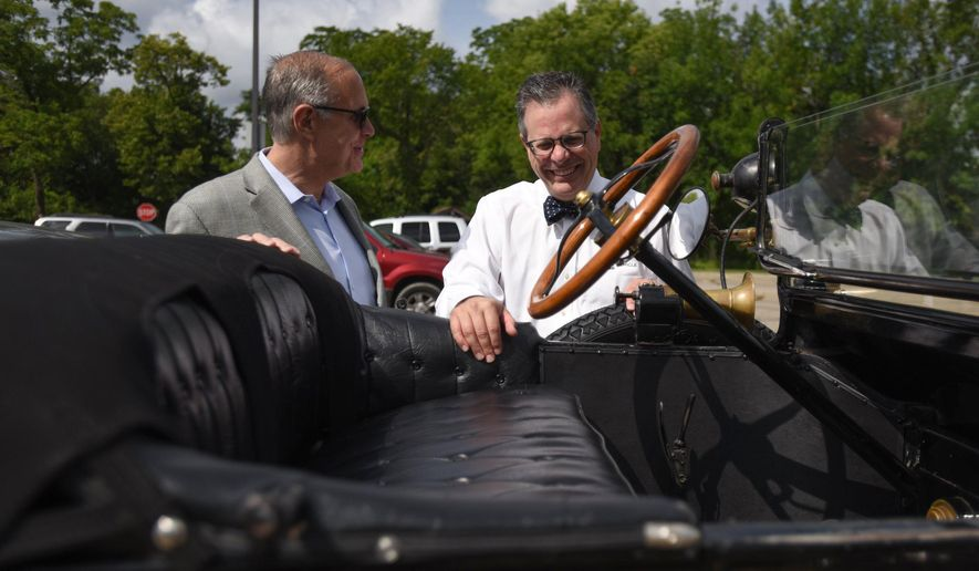 In this photo taken on Thursday, July 16, 2015, Historical Vehicle Association President Mark Gessler, right, chats with Randy Book, whose grandfather traveled with Edsel Ford in a Stutz vehicle in their cross-country road trip at Henry Ford's Fair Lane Estate in Dearborn, Mich.  Gessler and Heritage Specialist Casey Maxon will set off on a month-long road trip recreating Edsel Ford's cross country tour in their own 1915 Model T Touring Car for the centennial of this historic road trip. Edsel, the son of Henry Ford, at the age of 21 set off on this road trip with a group of friends from the Ford's Fair Lane Estate in Dearborn to San Francisco- all before the idea of the American 'road trip' was ever really born. (Tanya Moutzalias/The Ann Arbor News/MLive.com via AP) LOCAL TELEVISION OUT; LOCAL INTERNET OUT