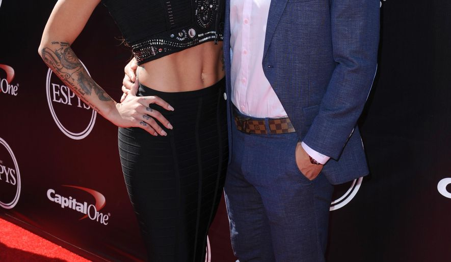 Sydney Leroux, left,  professional soccer player and Olympic gold medalist, and Dom Dwyer arrive at the ESPY Awards at the Microsoft Theater on Wednesday, July 15, 2015, in Los Angeles. (Photo by Richard Shotwell/Invision/AP)
