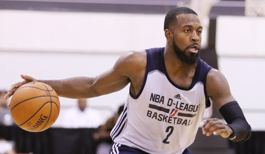 In this July 16, 2015, photo, NBA D-League Select's Justin Dentmon works with the ball during the second half of an NBA summer league basketball game against the Dallas Mavericks in Las Vegas. By the time training camps start this fall, Dentmon will be 30. He's played in eight NBA games for three franchises, never lasting long at any stop. In Las Vegas, he's part of the D-League Select squad, and he knows the odds against him are stacked higher than a 10-foot rim. Still, his mission is simple: Get noticed by an NBA team.(AP Photo/Ronda Churchill)