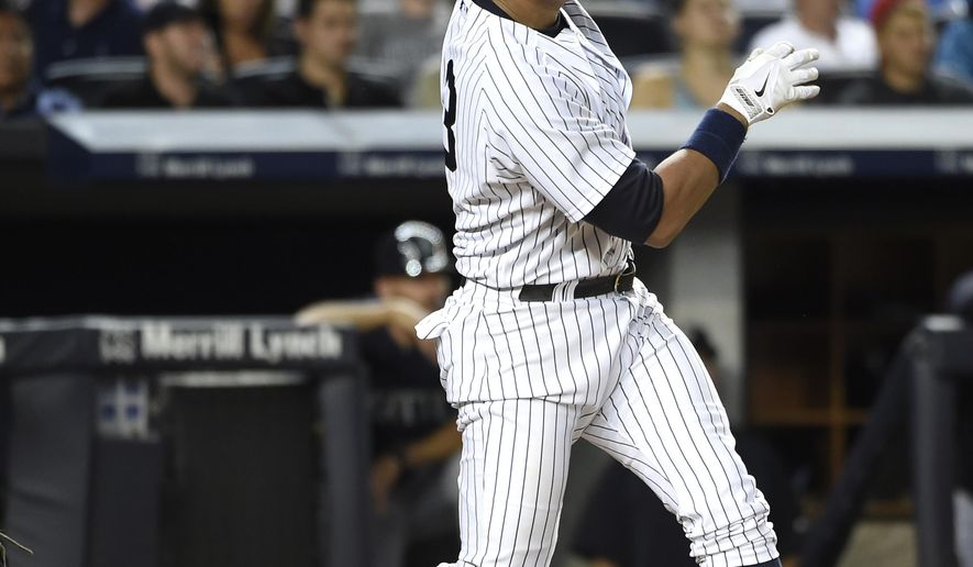 New York Yankees designated hitter Alex Rodriguez watches his solo home run off Seattle Mariners relief pitcher Joe Beimel during the seventh inning of a baseball game at Yankee Stadium on Friday, July 17, 2015, in New York. (AP Photo/Kathy Kmonicek)