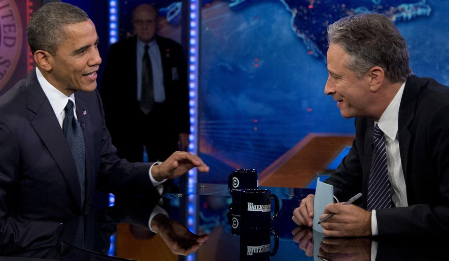 "FILE - In this Oct. 18, 2012 file photo, President Barack Obama talks with Jon Stewart during a taping of his appearance on ""The Daily Show with John Stewart"" in New York. Obama is booked for his seventh appearance on ""The Daily Show"" Tuesday as Jon Stewart is beginning his final three weeks as host of the show. Stewart announced earlier this year that he will be leaving ""The Daily Show"" after 16 years. His final broadcast will be on Aug. 6. (AP Photo/Carolyn Kaster, File)"