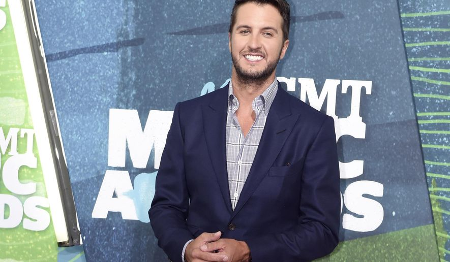 FILE - In this June 10, 2015 file photo, Luke Bryan arrives at the CMT Music Awards at Bridgestone Arena, in Nashville, Tenn. Bryan is launching a new mobile app with interactive features, exclusive content and live-streaming for fans. The multiplatinum singer with more than 4 million Twitter followers told The Associated Press that the app, available July 24, 2015, on iTunes and Google Play, will be another way for him to connect to his fans online. (Photo by Sanford Myers/Invision/AP, File)