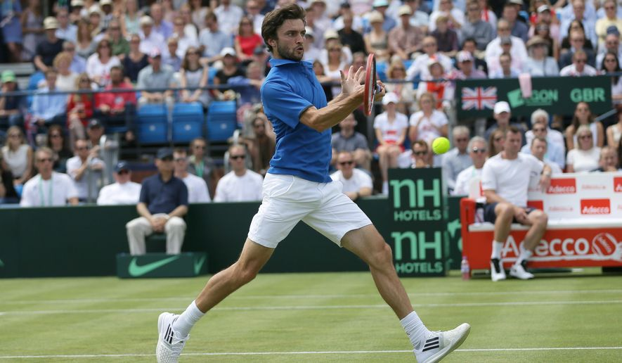 France's Gilles Simon plays a return to Britain's James Ward during the quarterfinal match between Britain and France in the Davis Cup at the Queen's Club in London, Friday July 17, 2015. (AP Photo/Tim Ireland)