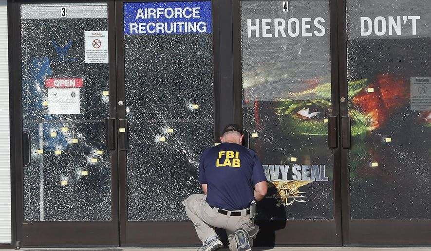 An FBI investigator investigates the scene of a shooting outside a military recruiting center on Friday, July 17, 2015, in Chattanooga, Tenn. Muhammad Youssef Abdulazeez of Hixson, Tenn.,  attacked two military facilities on Thursday, in a shooting rampage that killed four Marines. (AP Photo/John Bazemore) ** FILE **