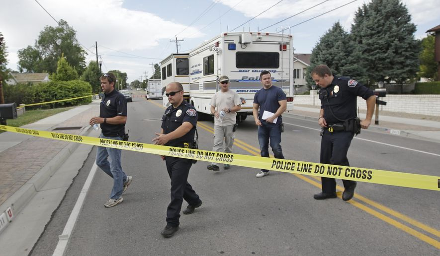 Police officials gather during an investigation after a 12-year-old girl was found dead Friday, July 17, 2015, in West Valley City, Utah. The search for the missing 12-year-old girl is now being investigated as a homicide after West Valley City police discovered the girl's body in a horse pasture. Police Chief Lee Russo says the girl's mother approached two officers at a convenience store near their home around 1:30 a.m. Friday,July 17, 2015. She told officers her daughter had been missing since midnight. (AP Photo/Rick Bowmer)