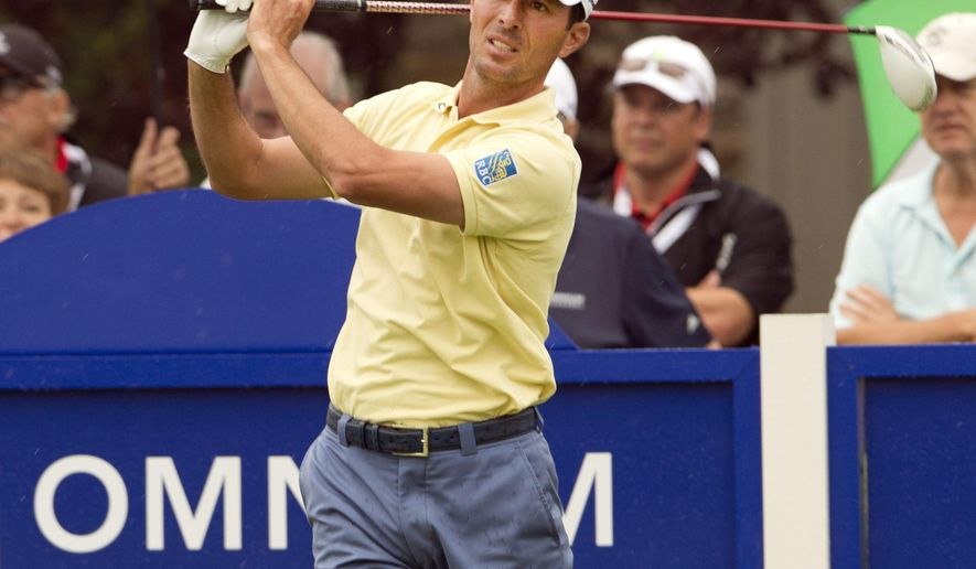 FILE - In this July 23, 2014, file photo, Canada's Mike Weir tees off during the pro-am event at the Canadian Open golf championship in Montreal. Former Masters champion Mike Weir is taking an indefinite leave of absence from the PGA Tour and will skip the RBC Canadian Open next week. Weir said only that he wants to focus on his personal life and his two daughters. (AP Photo/The Canadian Press, Ryan Remiorz, File)