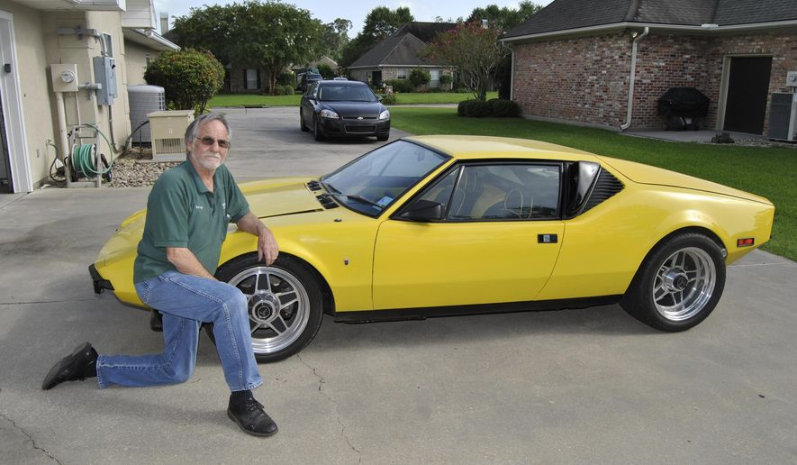 ADVANCE FOR MONDAY, JULY 20 - Sonny Walet of New Iberia, La., shows off his 1972 De Tomaso Pantera on July 8, 2015. After discovering that Walet's car was on the market, Nicolas Quentin from Bordeaux, France, stepped up to express interest. After seeing a real Pantera for the first time when he was around 10 years old, Quentin said the car has been on his mind ever since. (Corey Vaughn/The Daily Iberian via AP)