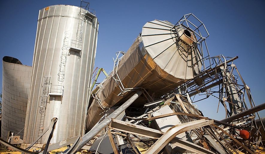 The twisted wreckage of several grain bins lie in a heap Friday July 17, 2015 in Cameron, Ill., the morning after a tornado swept through the city. At least three tornadoes hit communities in the northwest corner of Illinois and the central part of the state late Thursday, causing extensive damage but no significant injuries, officials said. (Steve Davis/The Register-Mail via AP)