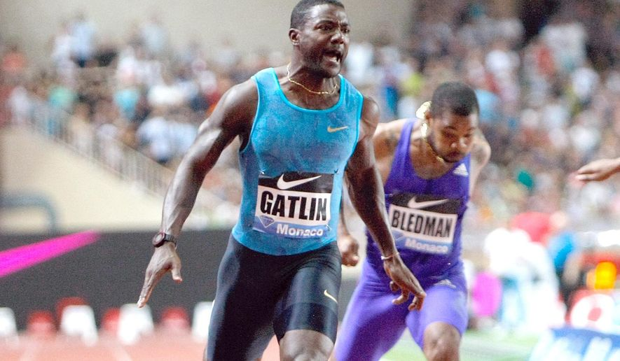 US Justin Gatlin wins  the 100m men's race  at the Herculis International Athletics Meeting, at the Louis II Stadium in Monaco, Friday, July 17, 2015. (AP Photo/Claude Paris)