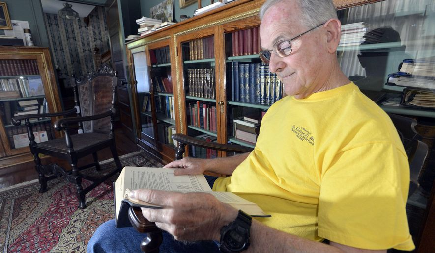 Tom Mudd in his Saginaw home with the Mudd family genecology on Wednesday July 15, 2015.  Mudd is the great grandson of Dr. Samuel Mudd, who treated assassin John Wilkes Booth's broken leg, and then told pursuing federal officers where to find him.  (Dale G Young/Detroit News via AP)  DETROIT FREE PRESS OUT; HUFFINGTON POST OUT; MANDATORY CREDIT
