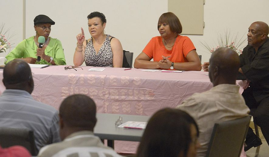 ADVANCE FOR MONDAY JULY 20 - In this Saturday, July 11, 2015 photo, panelists and breast cancer survivors, from left, Gwen Brooks, Sherrel Johnson and Sandra Porter lead a discussion for men on how they can better support women in their lives struggling with breast cancer at Camphor United Methodist Church in Baton Rouge, La. (Heather McClelland/The Advocate via AP)   MAGS OUT; INTERNET OUT; NO SALES; TV OUT; NO FORNS; LOUISIANA BUSINESS INC. OUT (INCLUDING GREATER BATON ROUGE BUSINESS REPORT, 225, 10/12, INREGISTER, LBI CUSTOM); MANDATORY CREDIT