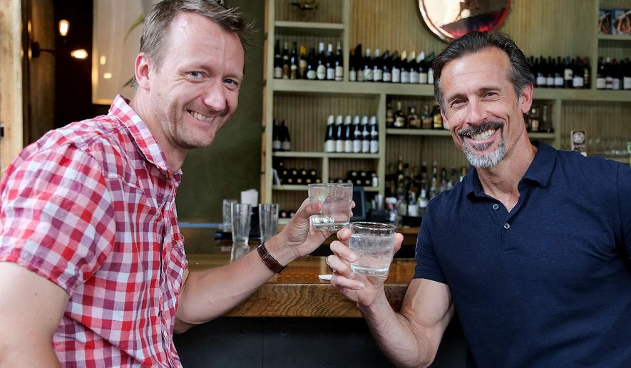 ADVANCE FOR WEEKEND EDITIONS JULY 18-19 - In this Monday, July 6, 2015 photo, Gordon Stewart, left, and Robbie Vitrano have a vodka drink in the bar at Peche in New Orleans, . They are partners in a new distillery, Bootleg Spirits, set to begin production this fall in Mid-City. (Eliot Kamenitz/The Advocate via AP)   MAGS OUT; INTERNET OUT; NO SALES; TV OUT; NO FORNS; LOUISIANA BUSINESS INC. OUT (INCLUDING GREATER BATON ROUGE BUSINESS REPORT, 225, 10/12, INREGISTER, LBI CUSTOM); MANDATORY CREDIT