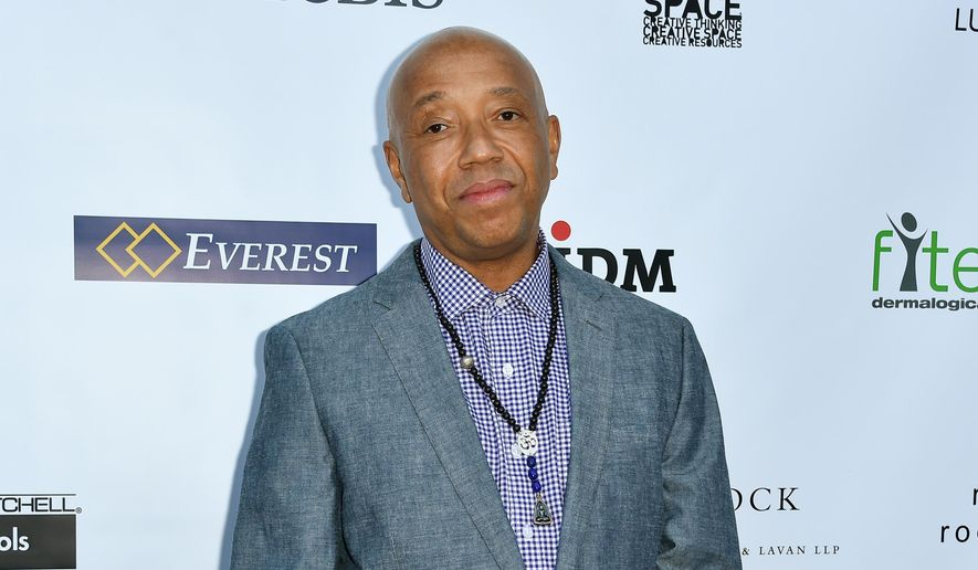 In this May 21, 2015 file photo, Russell Simmons arrives at The17th Annual CAST From Slavery to Freedom Gala in Los Angeles. (Photo by Rob Latour/Invision/AP, File)
