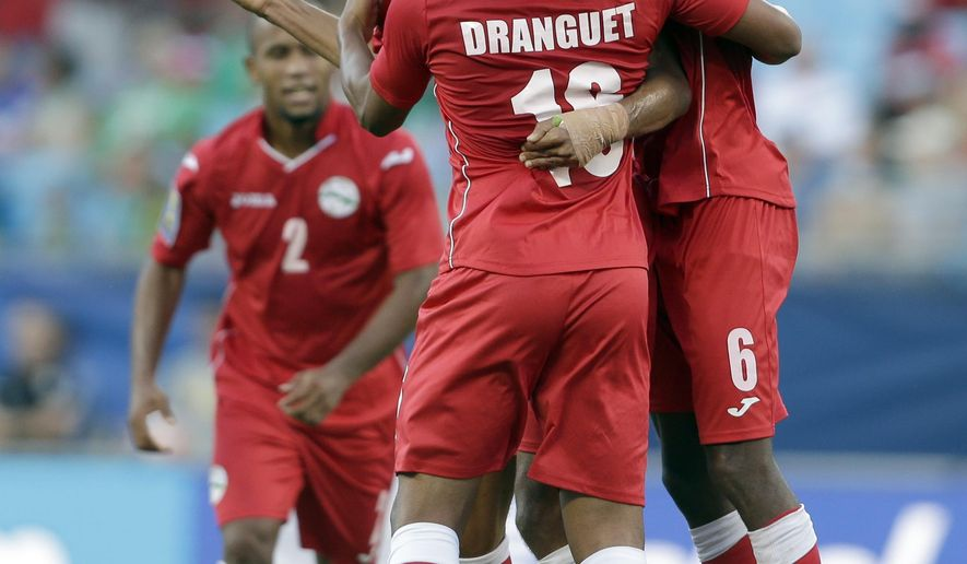Cuba players celebrate after a CONCACAF Gold Cup soccer match against Guatemala in Charlotte, N.C., Wednesday, July 15, 2015. Cuba won 1-0. (AP Photo/Gerry Broome)