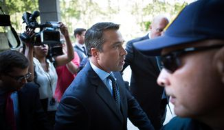 Former U.S. Rep. Michael Grimm, center, arrives ahead of his sentencing at federal court Friday, July 17, 2015, in the Brooklyn borough of New York. (AP Photo/Kevin Hagen)