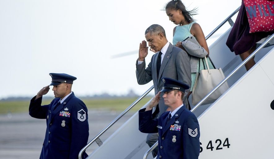 President Barack Obama, accompanied by Sasha Obama, right, departs Air Force One at JFK International Airport in New York, Friday, July 17, 2015. (AP Photo/Andrew Harnik)
