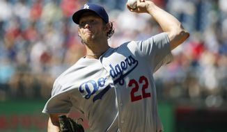 Los Angeles Dodgers starting pitcher Clayton Kershaw (22) throws during the first inning of a baseball game against the Washington Nationals at Nationals Park, Saturday, July 18, 2015, in Washington. (AP Photo/Alex Brandon)
