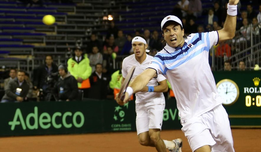 Carlos Berlocq, of Argentina, returns the ball during a Davis Cup doubles quarter finals tennis match with Serbia in Buenos Aires, Argentina, Saturday, July 18, 2015. (AP Photo/Daniel Jayo)