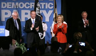 Democratic presidential candidates, from left, Bernie Sanders, Martin O'Malley, Hillary Rodham Clinton and Lincoln Chafee stand on stage during the Iowa Democratic Party's Hall of Fame Dinner, Friday, July 17, 2015, in Cedar Rapids, Iowa. (AP Photo/Charlie Neibergall) ** FILE **