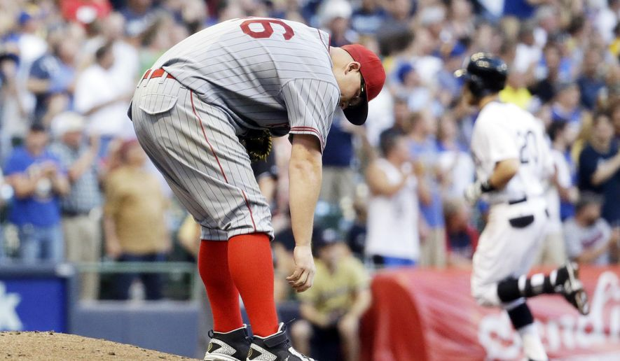 Pittsburgh Pirates starting pitcher Vance Worley reacts after giving up a two-run home run to Milwaukee Brewers' Jonathan Lucroy during the fourth inning of a baseball game Saturday, July 18, 2015, in Milwaukee. (AP Photo/Morry Gash)
