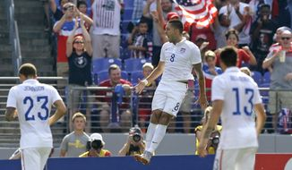 United States' Clint Dempsey (8) celebrates his goal against Cuba during the first half of a CONCACAF Gold Cup soccer quarterfinal match, Saturday, July 18, 2015, in Baltimore. (AP Photo/Patrick Semansky)