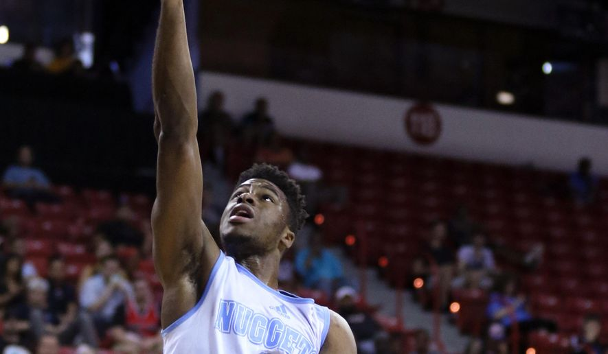 Denver Nuggets' Emmanuel Mudiay, left, lays up the ball near Atlanta Hawks' Lamar Patterson during the first half of an NBA summer league basketball game Thursday, July 16, 2015, in Las Vegas. (AP Photo/Ronda Churchill)