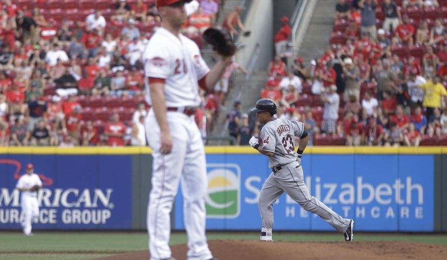 Cleveland Indians' Michael Brantley, right, runs the bases after hitting a three-run home run off Cincinnati Reds starting pitcher Anthony DeSclafani, front, in the first inning of a baseball game, Saturday, July 18, 2015, in Cincinnati. (AP Photo/John Minchillo)