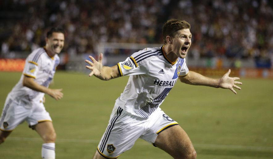 Los Angeles Galaxy's Steven Gerrard, of England, celebrates his first goal for the team, during the first half of an MLS soccer match against the San Jose Earthquakes, Friday, July 17, 2015, in Carson, Calif. (AP Photo/Jae C. Hong)