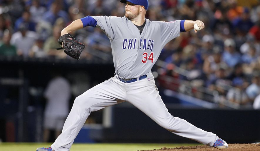 Chicago Cubs starting pitcher Jon Lester throws in the seventh inning of a baseball game against the Atlanta Braves, Saturday, July 18, 2015, in Atlanta. (AP Photo/Brett Davis)