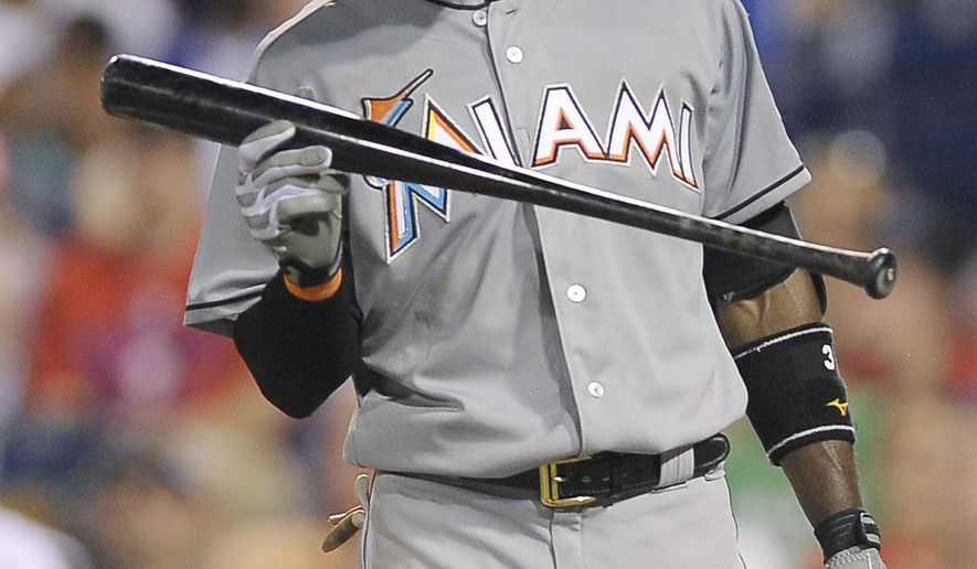 Miami Marlins' Adeiny Hechavarria throws his bat after striking out in the eighth inning of a baseball game against the Philadelphia Phillies, Saturday, July 18, 2015, in Philadelphia. The Phillies won 3-1. (AP Photo/Michael Perez)